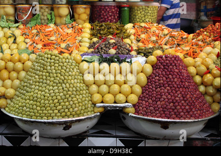 Market stall selling fresh olives and bottled food in Marrakech, Morocco - Stock Photo