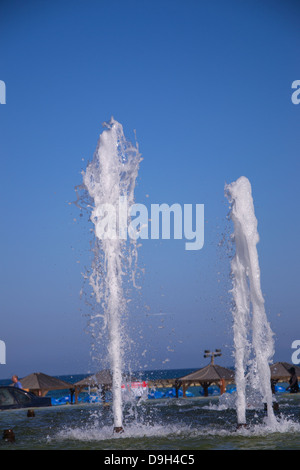 Splashes of fountain water in a fine day - Stock Photo