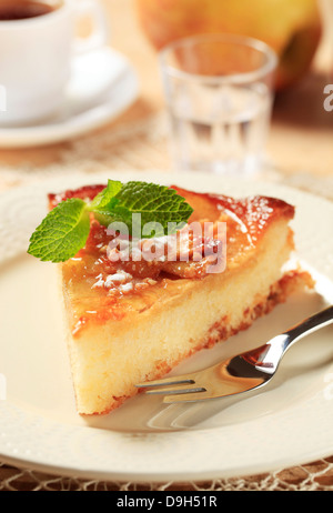 Piece of sponge cake topped with sliced apples - Stock Photo