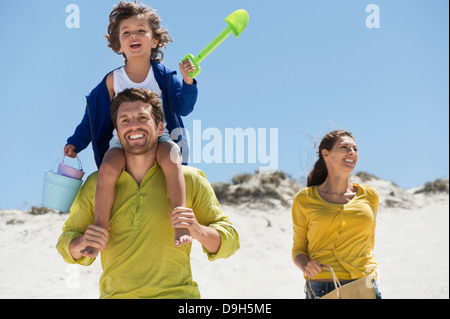 Family enjoying on the beach - Stock Photo