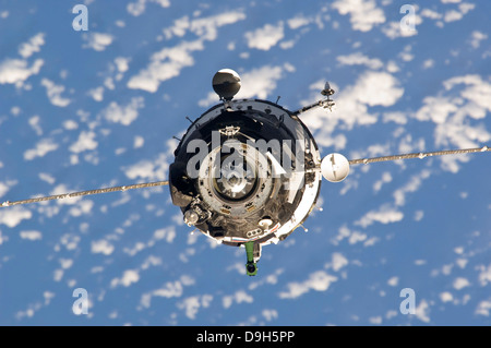 October 9, 2010 - The Soyuz TMA-01M spacecraft approaches the International Space Station. - Stock Photo
