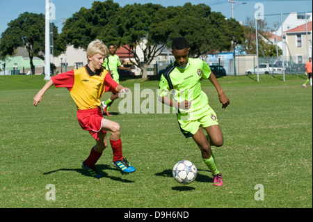 U15 Junior football teams playing a league match, Cape Town, South Africa - Stock Photo