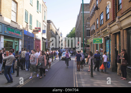 View along Brick Lane in London's East End - Stock Photo
