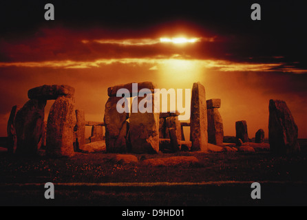 Composite of a sunset over Stonehenge, Wiltshire, England. - Stock Photo