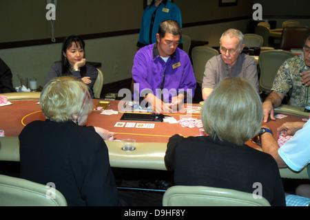Nevada Las Vegas The Strip South Las Vegas Boulevard Circus Circus Hotel Casino poker table gamblers gambling luck - Stock Photo