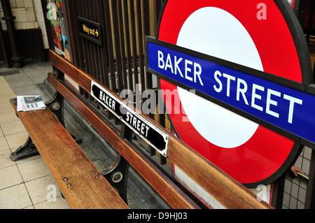 London, England, UK. Baker Street underground station. Bench and roundel - Stock Photo
