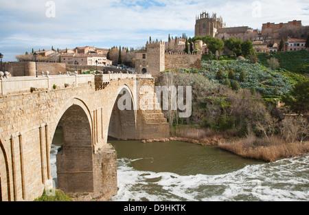 Toledo - Look to San Martin s bride or Puente de san Martin to Monastery of saint John of the King in morning light - Stock Photo