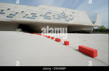 Red cubes have been placed in front of the Phaeno Science Center in Wolfsburg, Germany, 03 May 2013. Photo:JOCHEN - Stock Photo