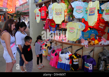 Nevada Las Vegas Downtown Fremont Street Experience pedestrian mall woman mother boy son girl daughter family souvenir - Stock Photo
