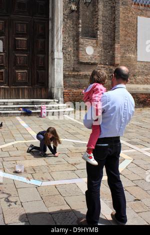 Family street scene in Venice Stock Photo