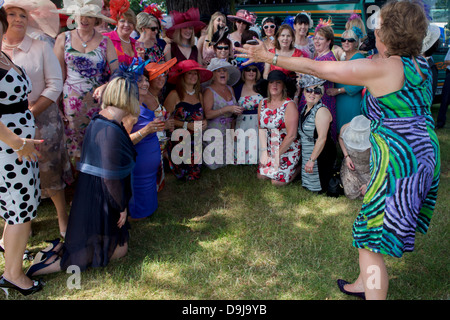 A womens' daytrip group from Wales enjoy a summer's morning, hours before horse racing starts during the annual - Stock Photo