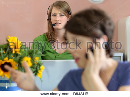 Businesswomen working in an office - Stock Photo