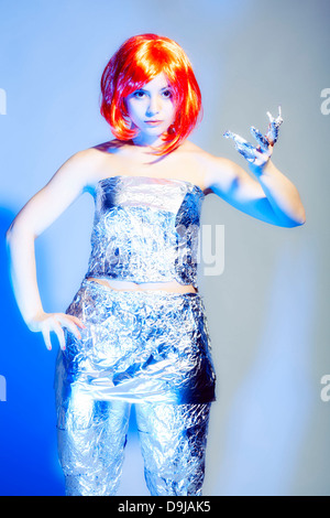 Young woman in tin foil - Stock Photo