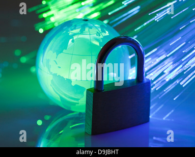 Padlock with crystal globe - Stock Photo