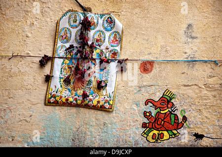 Detail of Gods on a wall. Varanasi, Benares, Uttar Pradesh, India - Stock Photo
