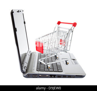 Online shopping. Shopping cart with laptop on white. - Stock Photo