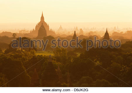 The temples and pagodas of the ancient city Bagan at sunrise, in Myanmar - Stock Photo