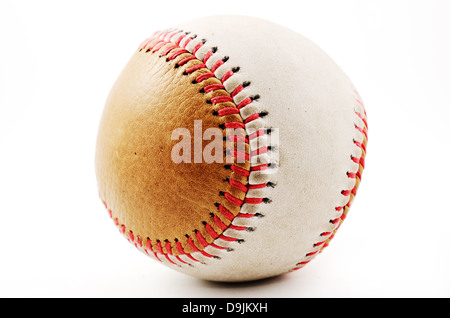 dirty baseball, white and brown on a light background, close-up - Stock Photo