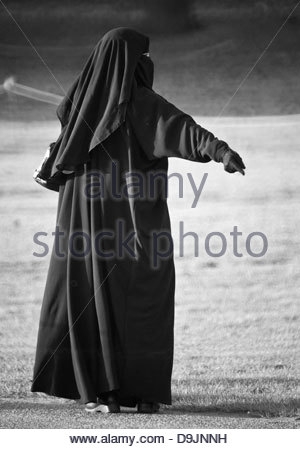 young woman wearing burka black hijab - Stock Photo