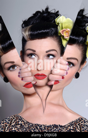 Woman splitting out of pictures - bipolar creative concept - Stock Photo