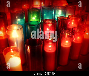 Spiritual candles as a candlelight memorial in a religious ceremony as a commemorative tradition in religion to - Stock Photo