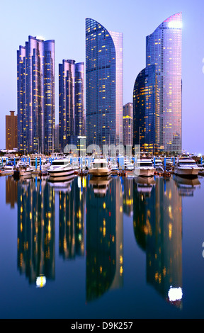 Skyline of luxury residential high rises in the Haeundae district of Busan, South Korea at dusk. - Stock Photo