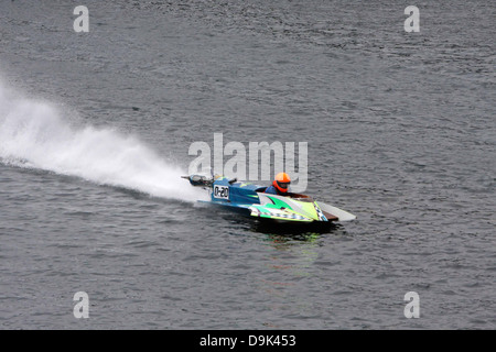 outboard boat races on water river - Stock Photo