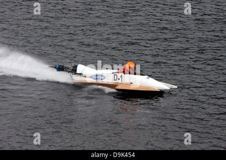 outboard boat race on water river - Stock Photo