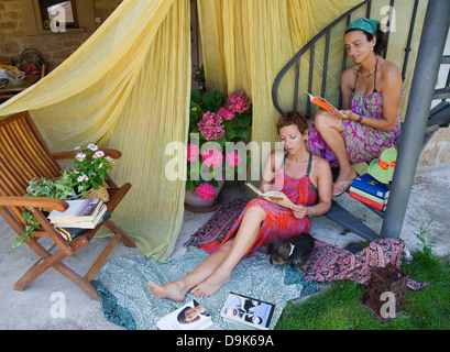 two young women reading - Stock Photo