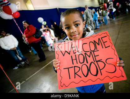 Young John Parker Jr. holds a sign celebrating his father's return from deployment March 1, 2009 at Misawa Air Base, - Stock Photo