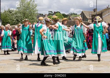 Female Morris dancers at Skipton, North Yorkshire, England - Stock Photo