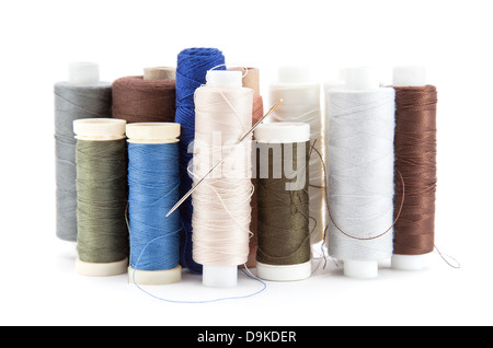 Spools of thread isolated on white - Stock Photo