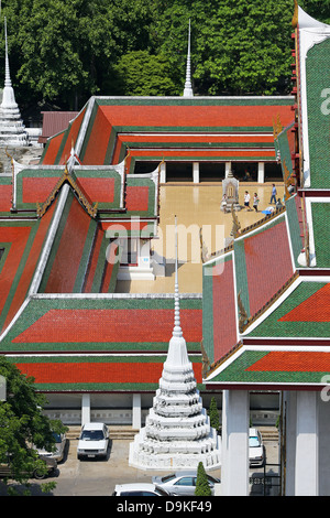 Colourful tiles on the roofs of Wat Ratchanatdaram Temple, Bangkok, Thailand - Stock Photo