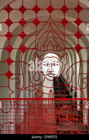 Face design in metal ironwork in Wat Ratchanatdaram Temple, Bangkok, Thailand - Stock Photo