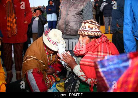LA PAZ, BOLIVIA, 21st June. A female Aymara amauta or spiritual blesses a suyu ( llama foetus) while preparing a - Stock Photo