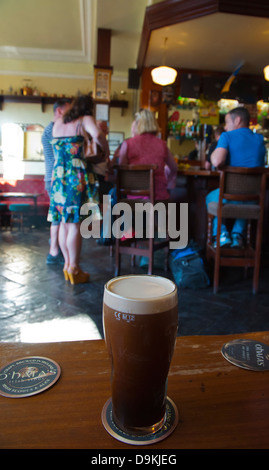 Pint of Guinness in Merchants Arch pub Temple Bar entertainment area central Dublin Ireland Europe - Stock Photo