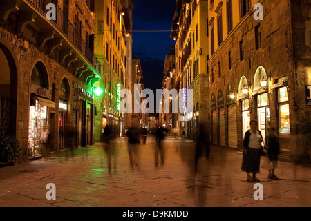 Long exposure image taken at night in Via dei Calzaiuoli, Florence, Italy. - Stock Photo