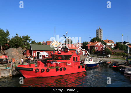 Pilot boat in the harbor of Landsort Island (Oeja), harbor, Stockholm Archipelago, baltic sea coast, Sweden, Scandinavia - Stock Photo
