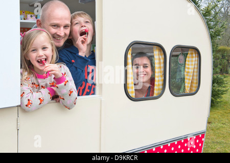 Portrait of family in caravan - Stock Photo