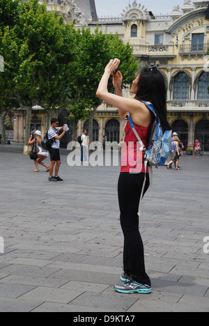 tourists taking pictures near Ramblas Barcelona Spain - Stock Photo