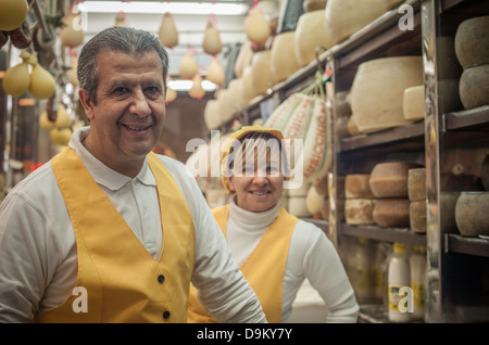 Man and woman in cheese shop - Stock Photo