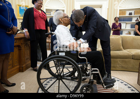 US President Barack Obama talks with Thelma Maxine Pippen McNair, mother of Denise McNair, after signing H.R. 360 - Stock Photo