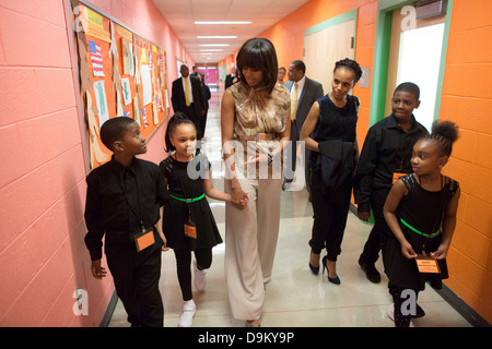 US First Lady Michelle Obama walks with students during a visit at Savoy Elementary School May 24, 2013 in Washington, - Stock Photo