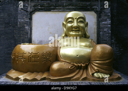 Laughing Buddha in Five Springs Park Wuquan Shan Gongyuan in the northwest part of Gaolan Mountain, which stands - Stock Photo