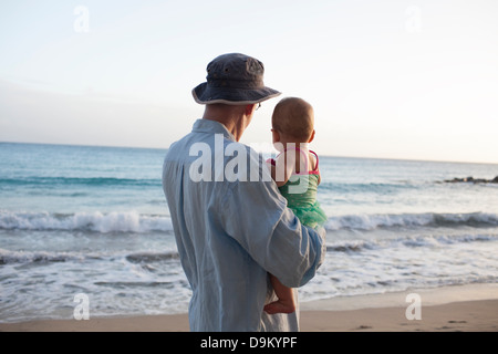 Grandfather with granddaughter on beach, St Maarten, Netherlands - Stock Photo