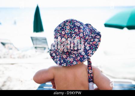 Baby girl wearing sunhat, St Maarten, Netherlands - Stock Photo