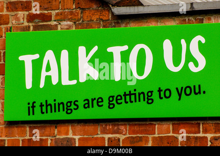 Talk to us sign on a Samaritans building - Stock Photo