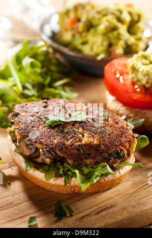 Homemade Organic Vegetarian Mushroom Burger with tomato and guacamole - Stock Photo