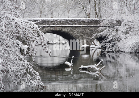 Snow Covered Trees Framing A Stone Bridge And River During Winter In The Park, Sharon Woods, Southwestern Ohio, - Stock Photo