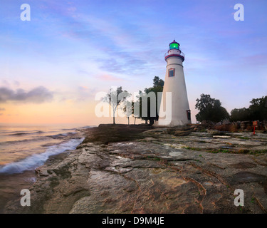 The Marblehead Lighthouse Bathed In The First Light Of Dawn On A Foggy Morning Over Lake Erie At Marblehead Ohio, - Stock Photo